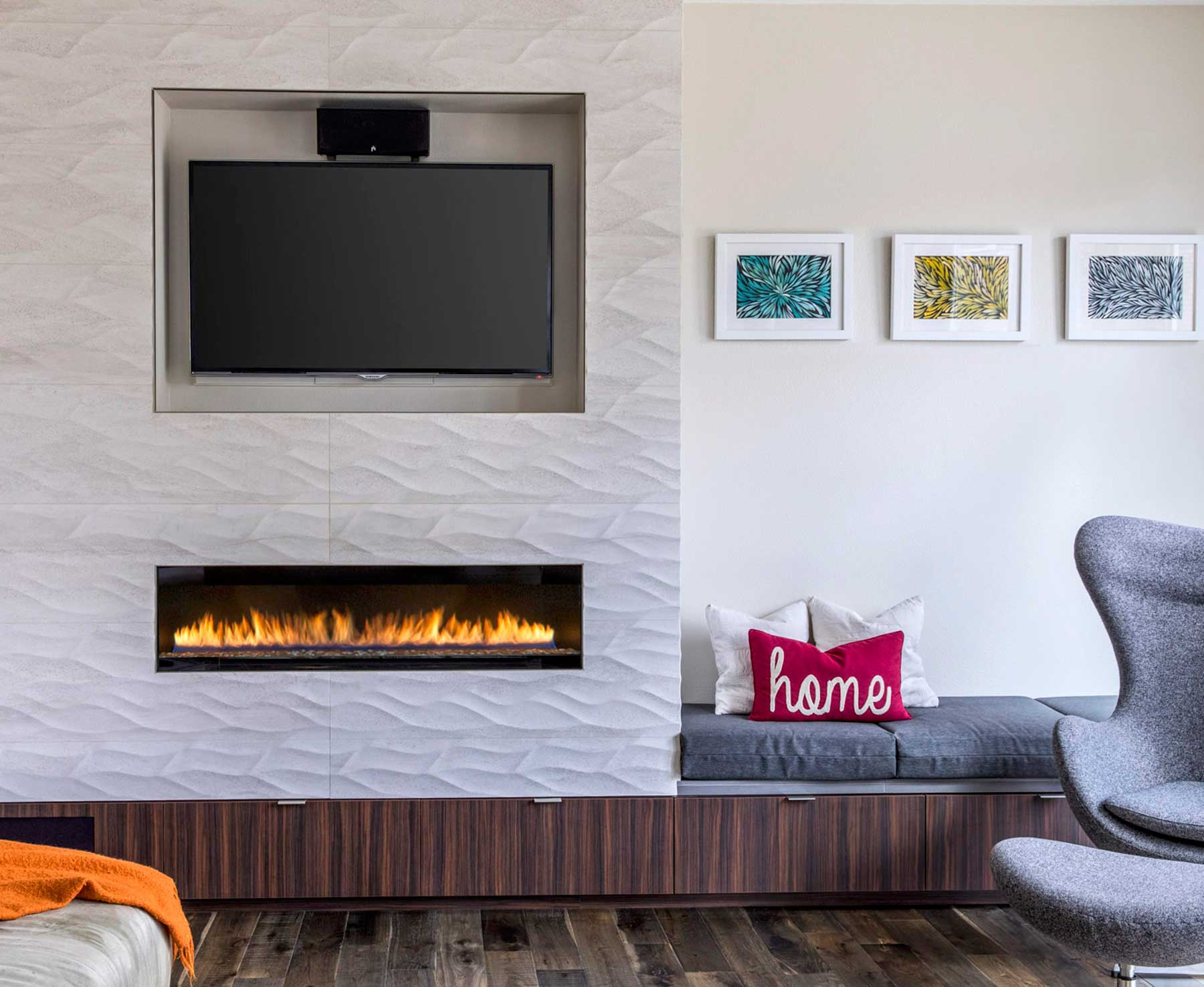 Kitchen remodel with a built in floating fireplace and built in tv