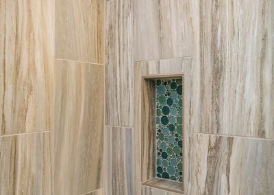 Bathroom-Shower-with-Full-Custom-12x24-Tile-Walls-and-Accent-Bubble-Tile-Strips-with-Tile-Shower-Niche