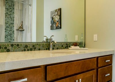 Bathroom-with--Light-Brown-Vanity-Under-Mount-Sink-and-Bubble-Tile-Strip-Backsplash-with-Matching-Tile-Shower