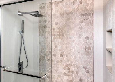 Frameless-Glass-Shower-Palazzo-Chrome-Shower-System-Hex-Tile-and-Textured-Tile-Shower-Walls-Bathroom