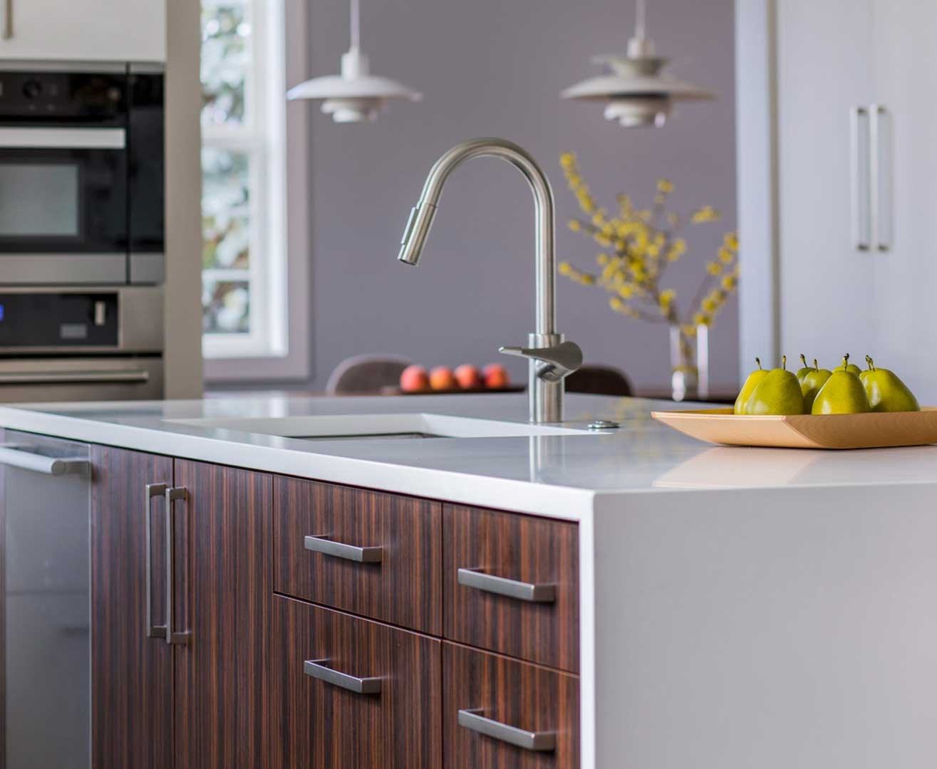 Remodeled kitchen island with gooseneck faucet