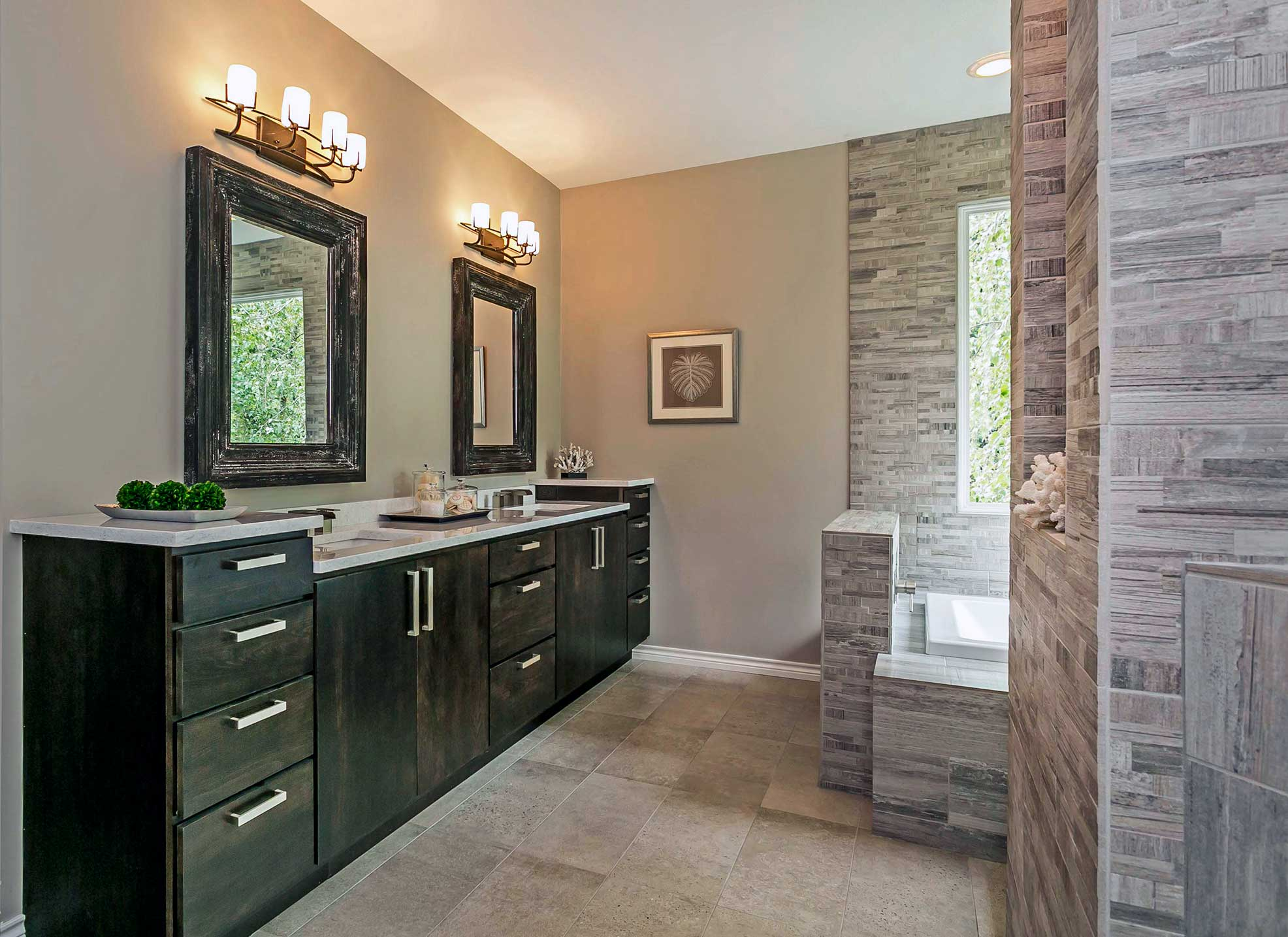 Bathroom remodel in Portland with double vanity, dark wood, and walk in shower