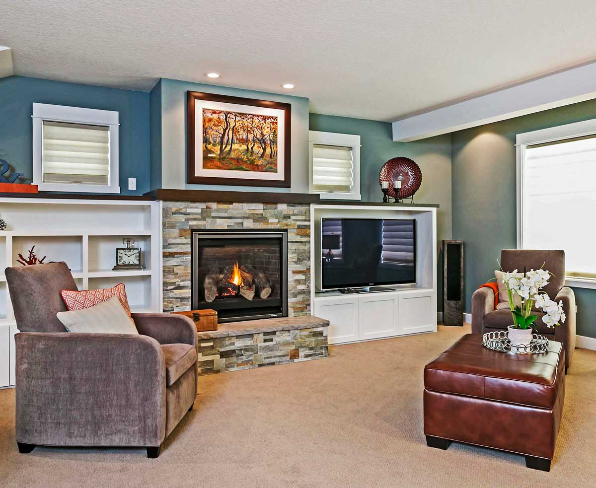 Modern living room remodel with built in floating fireplace and built in television