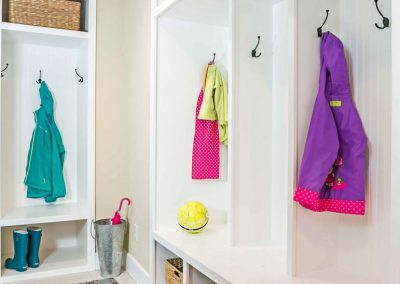 Tile-Floor-Mudroom-with-framed-Cubbies-and-Cabinets-for-Coats-Boots-and-Island-Rug