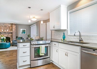 Transitional-Open-Kitchen-Undermount-Sink-Gloss-Subway-Tile-White-Cabinets