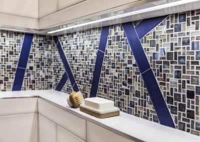 Full length shower niche with LED lighting and mosaic accent tile