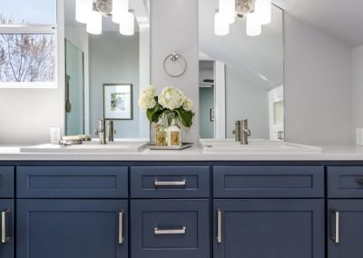 Master bath with shaker cabinets brushed nickel pulls quarts counter top mount sinks counter to ceiling vanity mirrors over mirror sconce lights calcuta tile floor