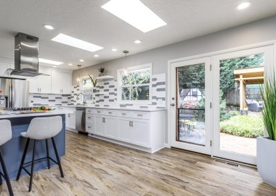 Transitional SW Portland Open Kitchen Wood Floors White Cabinets Blue Island Accent Cabinets