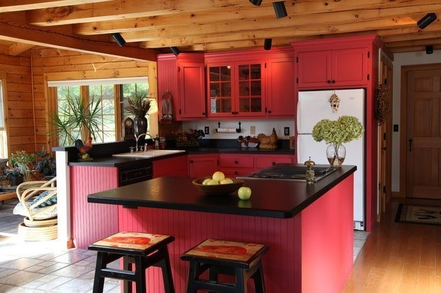 Bold Red Paired with Sleek Black and Natural Elements Kitchen Design